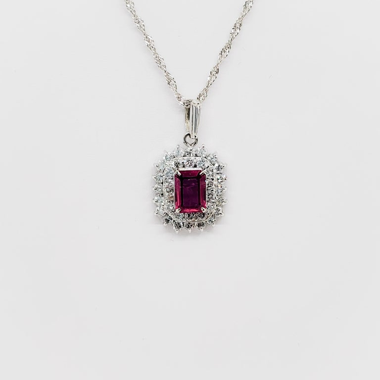 Classy and beautiful estate ruby emerald cut pendant showcasing 1.18 ct ruby and 1.16 ct of good quality, white, and bright diamond rounds.  Forever in style design in a handmade platinum mounting and 16