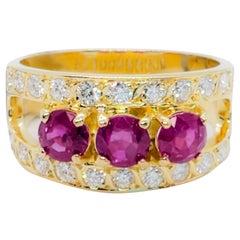 Estate Ruby Round and White Diamond Round Ring in 14 Karat Yellow Gold