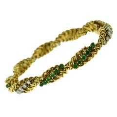 Estate Tiffany & Co. Emerald and Diamond Swirl 18 Karat Yellow Gold Bracelet