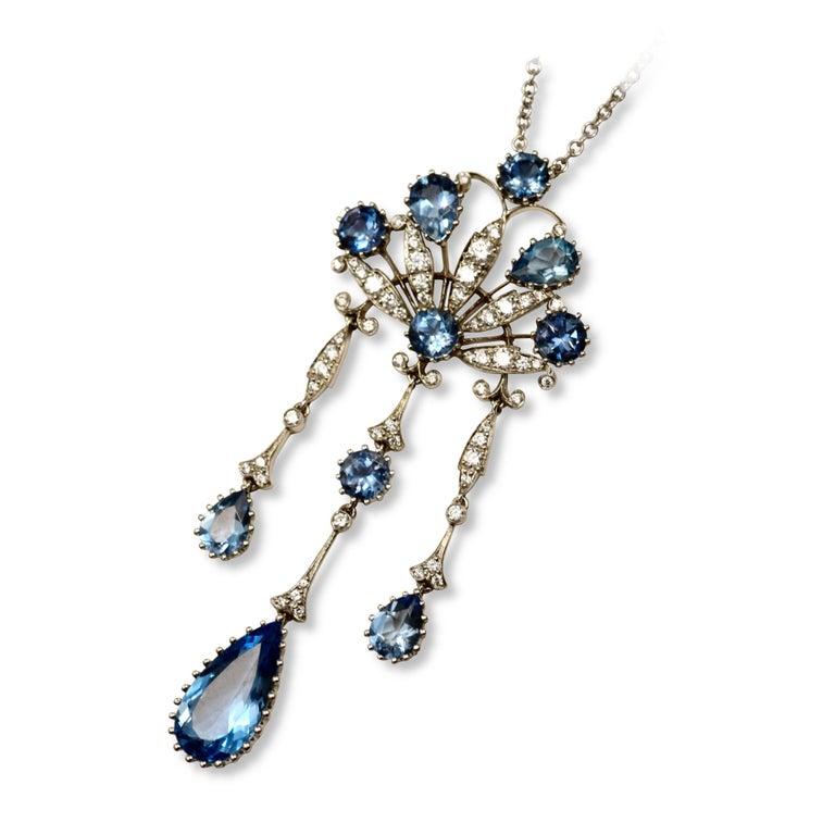 Brand: Tiffany & Co.  Style: Pendant Necklace   Metal: Platinum    Metal Purity: 950  Stone: Round Brilliant Cut Diamonds                 Round & Pear Shaped Aquamarine  Chain Length: 14.96