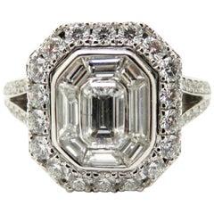 Estate Vintage 18 Karat White Gold Emerald Cut and Round Diamond Halo Ring