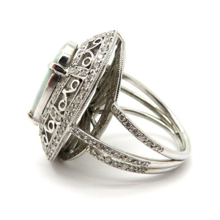 Estate Vintage Platinum 2.03 Black Opal Diamond Halo Ring In Excellent Condition For Sale In Scottsdale, AZ
