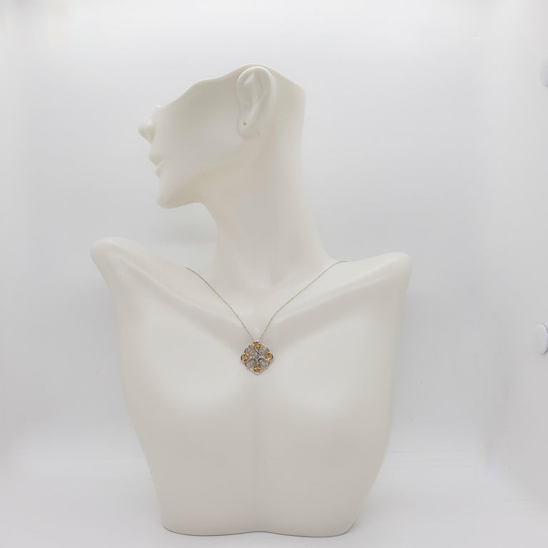 Beautiful everyday pendant with 0.22 ct. good quality white diamond rounds in a handmade 18k two tone mounting.  18