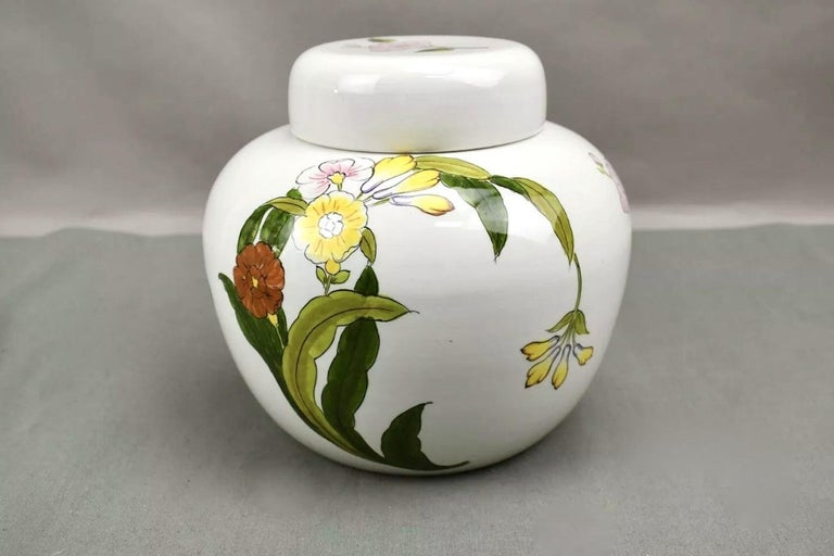 Este Ceramiche for Tiffany & Co. Hand painted floral sweetheart porcelain vase and lid, urn or perhaps even a cookie jar. Lovely, rare piece. Gorgeous placement of the blossoms, accentuates the bubble-like form of vessel.