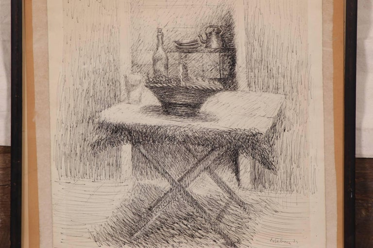 Pen and ink on paper. Still life with a table set with a basket and wine, in front of a cabinet with plates and a tea kettle. Signed and dated 1934 in the lower right. Numbered 28 in pencil lower left corner. Taped to card at the top in the frame.
