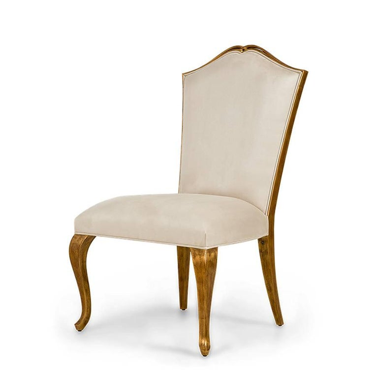 Chair Estiva with structure in handcrafted veneer mahogany wood with gold painting. With high quality  satin white fabric. Also available with others fabrics.