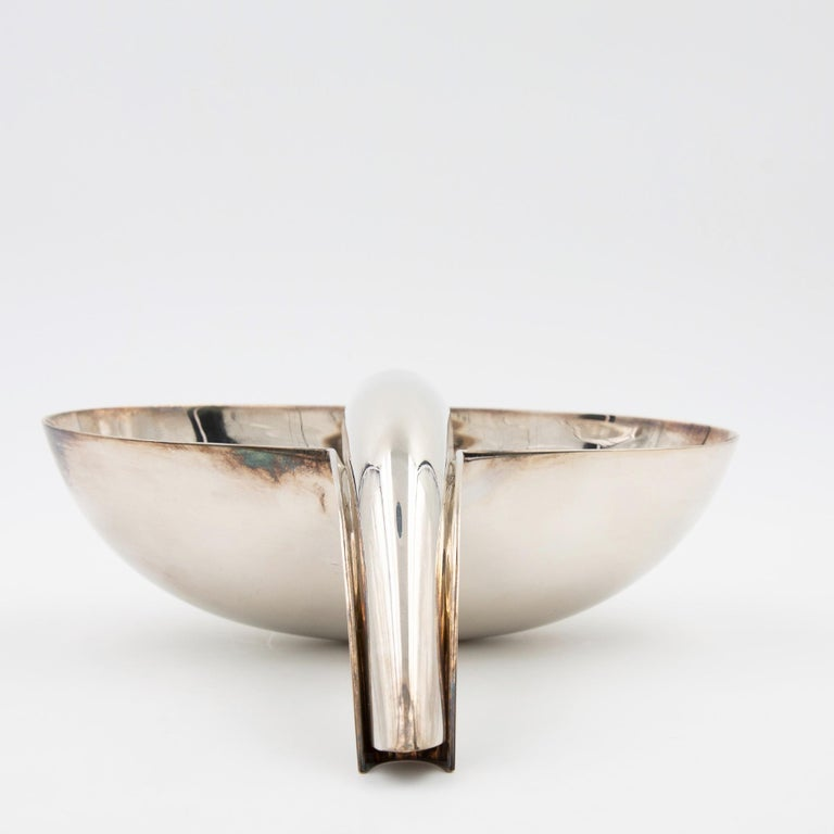 A rare large sauceboat designed and manufactured by Lino Sabattini in 1973 This item can be used as a vide poches or a bonbonnière it's like a sculpture Silvered metal You can play with the spoon, put it inside the bowl or let it on the