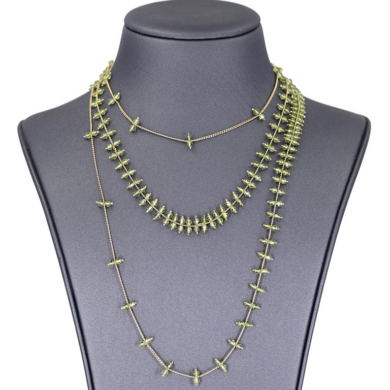 Rain Necklace hand-fabricated by jewelry maker Estyn Hulbert featuring a gorgeous double cascade of individually-set faceted peridot beads all strung on 50 inches of lustrous 14k gold-filled chain. Wearable at multiple lengths.   About the Maker -