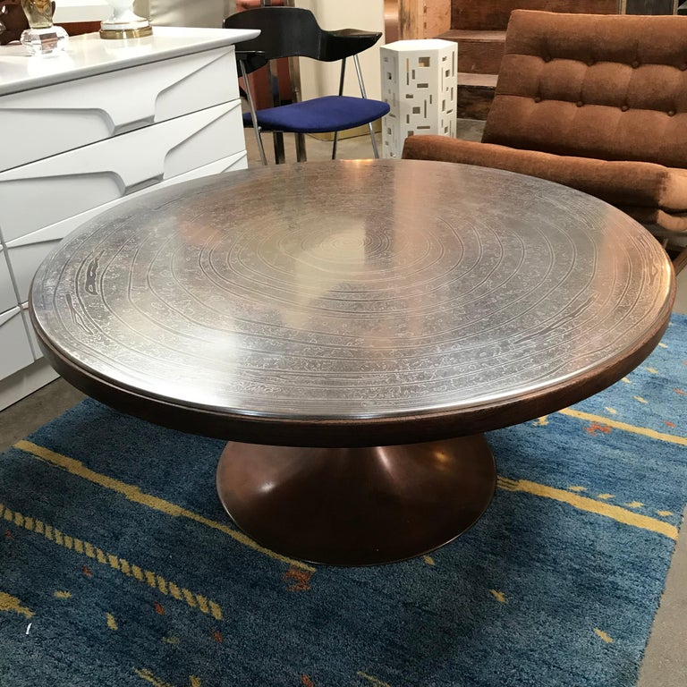Amazing and rare etched pewter top coffee table by Christian Krekels. The top inserts in a 2