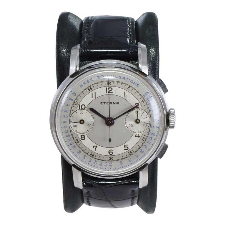 FACTORY / HOUSE: Eterna Watch Company STYLE / REFERENCE: Art Deco / Two Register Chronograph / 30 Pulsations METAL / MATERIAL: Stainless Steel  DIMENSIONS: 47mm X 37mm CIRCA: 1930's MOVEMENT / CALIBER: Manual Winding / 17 Jewels  DIAL / HANDS: