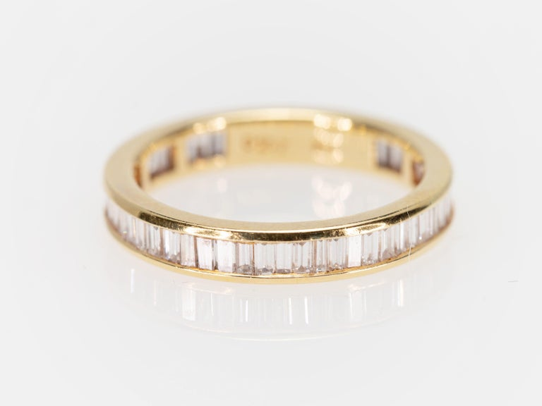 Eternity Baguette Cut 1.57 Carat Diamond Band Ring in 18 Karat Yellow Gold 1980s In Good Condition For Sale In Miami, FL