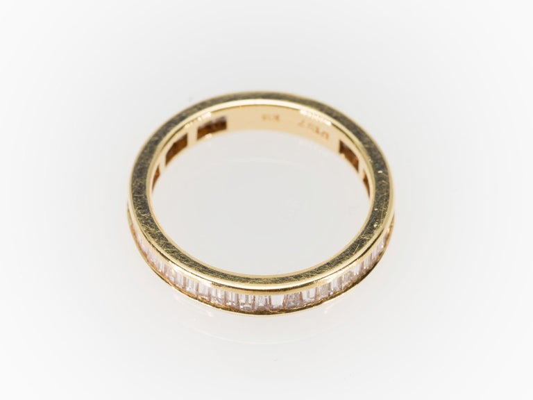 Eternity Baguette Cut 1.57 Carat Diamond Band Ring in 18 Karat Yellow Gold 1980s For Sale 1