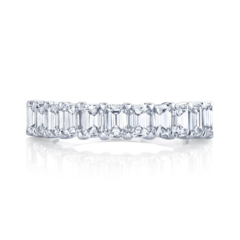 Halfway Eternity Band with 11 Emerald Cut Diamonds set in 18k white gold. 11 stones 1.65 carat total weight  Approximate Color G - I  Clarity VVS - VS   Ring size 6.5