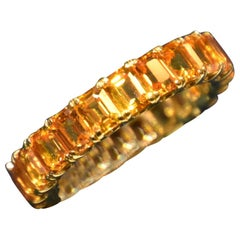 Eternity Orange Sapphire Ring in Yellow Gold