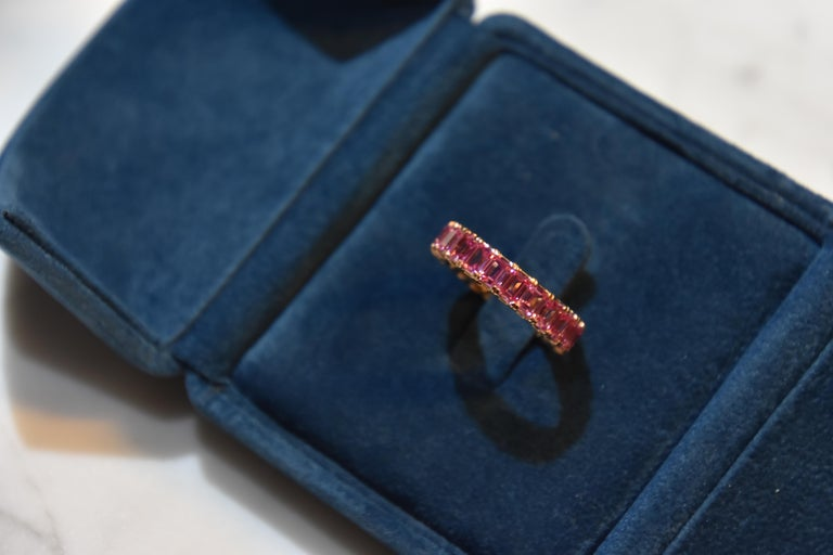 Each pink sapphire stone 0.24 carat. Total 22pcs/  5.21 carat pink sapphire Eternity Ring set in 18K rose gold. You can order your own size. It takes around 4 weeks for delivery.  Ring size- US 6.25,   Kahn also provide engraving, resizing and