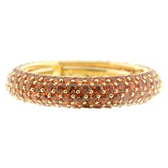 Eternity Ring in Orange Sapphire and 18 Karat Yellow Gold