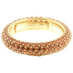Eternity Ring in Orange Sapphire and 18 Karat Yellow Gold