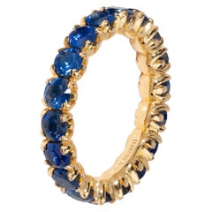 Eternity Ring With Royal Blue Sapphires in 18 Karat Yellow Gold