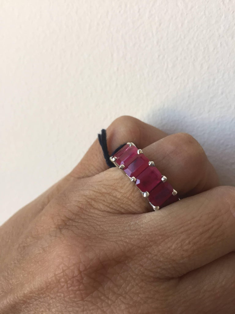 Exquisite one of a kind eternity, Burma Ruby Ring set in 14K white gold. The stones in this ring are emerald cut. The total weight of this stunning ring is 10.05 carats. The ring is a size 6. All our pieces comes with an appraisal, performed by our
