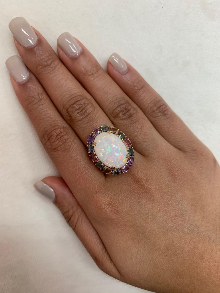 Sunita Nahata presents an exquisite Ethiopian Opal cabochon ring accented with rainbow sapphires and dazzling diamonds to accentuate the fire and sparkle within this colorful opal. The gorgeous and colorful gems on this ring will grab every