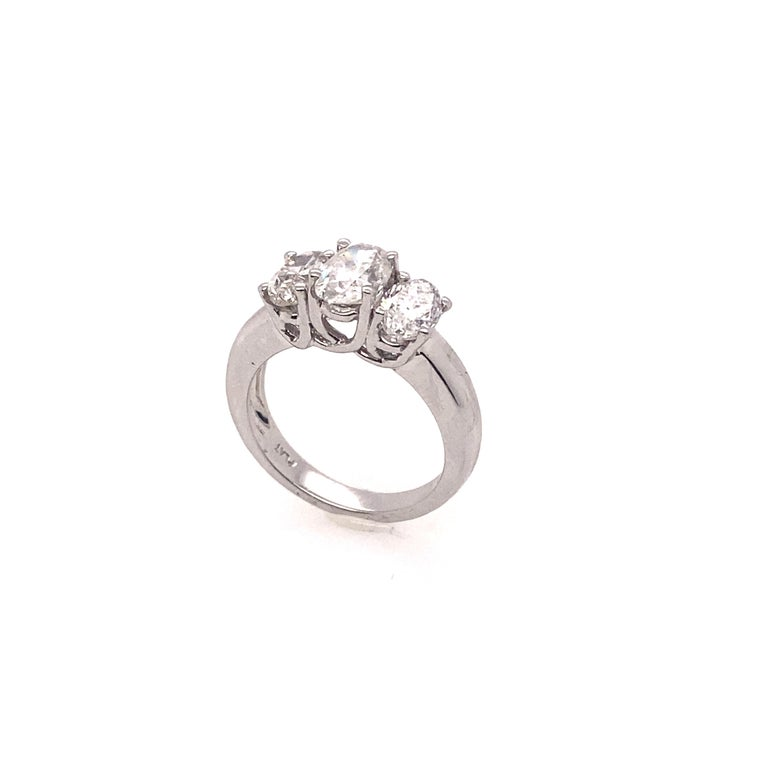 The three oval diamonds are set in the platinum ring. The center oval diamond is EGL certified as a weight of 1.10 carat, F I1 clarity. The ring band is thick and it gives the powerful and elegant impressions. It is very perfect for who loves the