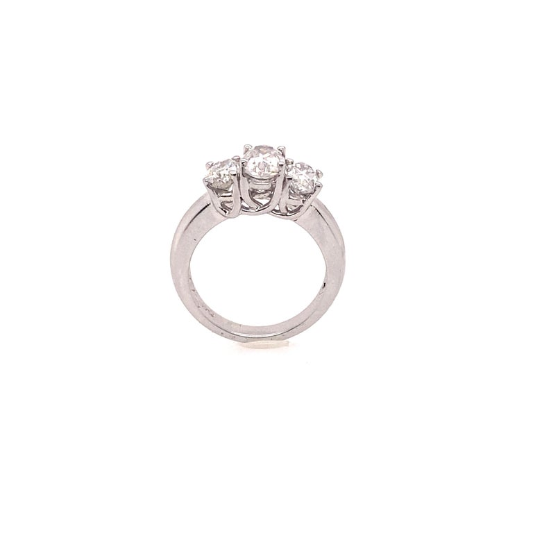 Contemporary Ethonica Certified Three-Stone Diamond Ring in Platinum For Sale