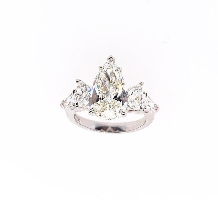 Contemporary Ethonica GIA Certified Pear Diamond Ring in Platinum For Sale