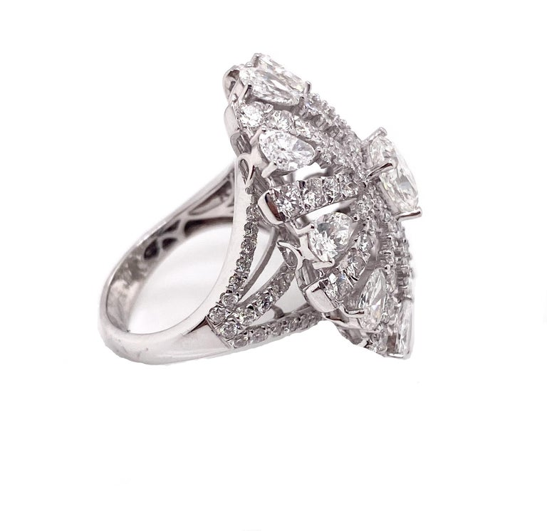 The center stone 1.00 carat cushion diamond is surrounded by the pear shape and round shape diamonds like a sunflower design. It features for any occasion to make stylish statement.   Center Stone Weight: 1.00 carat Center Stone Shape: