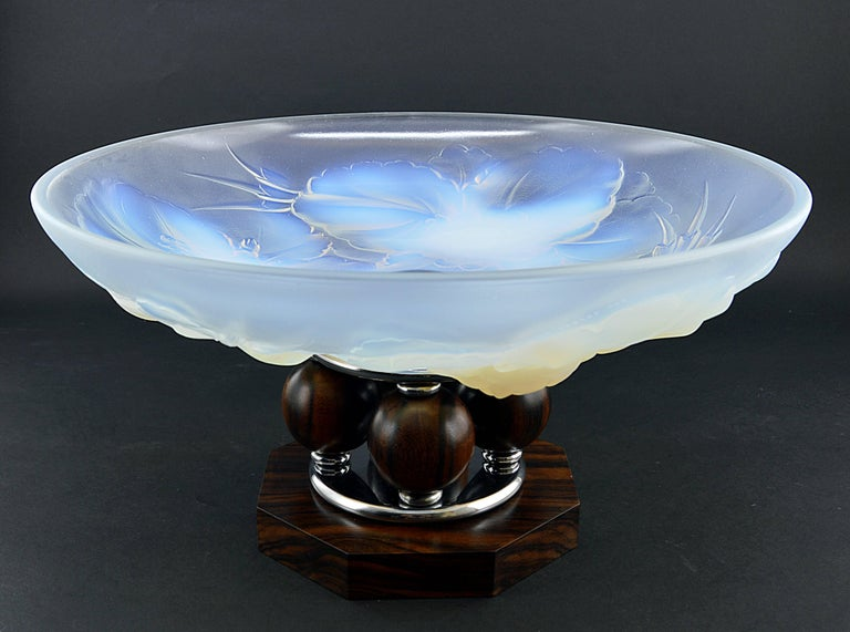 Summer sales. We are renewing our stock waiting for the start of September. Do not wait to order this beautiful period piece, we only have one. Thick opalescent molded glass bowl on a Macassar ebony and chromed metal base. The famous one with four