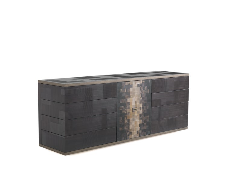 The new glossy dark wengé spatula finish lending a rough effect to the piece is one of the main features of the Aleppo sideboard, a contemporary piece of furniture able to withstand trends thank to its timeless ethnic inspiration, confirmed by the