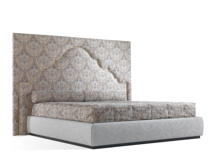 An imposing and elegant bed featuring an important headboard enriched by decorative nails creating a suggestive oriental inspired motif. Mixing classic charm and Indian spiritual suggestions, the Bombay bed expresses Etro's mystical mood and