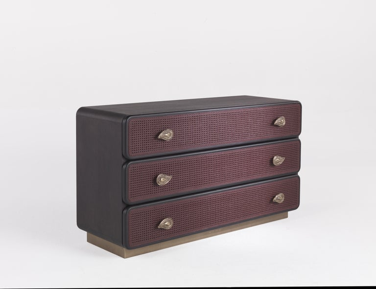 Nomadic spirit, travel suggestions and natural inspirations. This chest of drawers with matte bordeaux cane and paisley handle in polished brass is a mix of references and suggestions in perfect Etro Home Interiors style.  Top and sides covered in