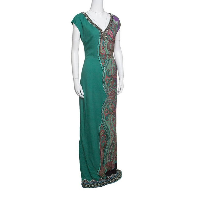 Etro's maxi dress strikes a stunning balance between contemporary style and dreamy silhouette. The signature paisley print adorning the half side of this dress and striking embellishments accented on the V-neckline create an aura of elegance and
