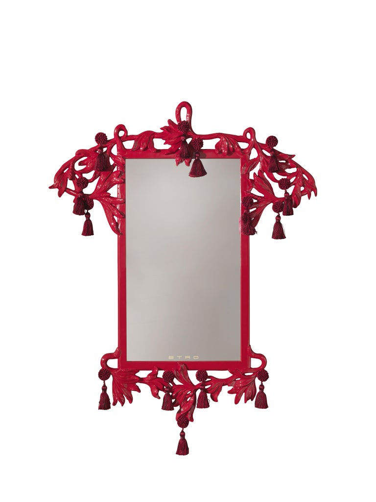 Striking, magical and spectacular, the Nymph mirror is protagonist of a story between fairy tale and mythology. The wood carvings evoke the powerful nature of the Nymphs, while the lacquered red color gives a strict intensity to the design. The