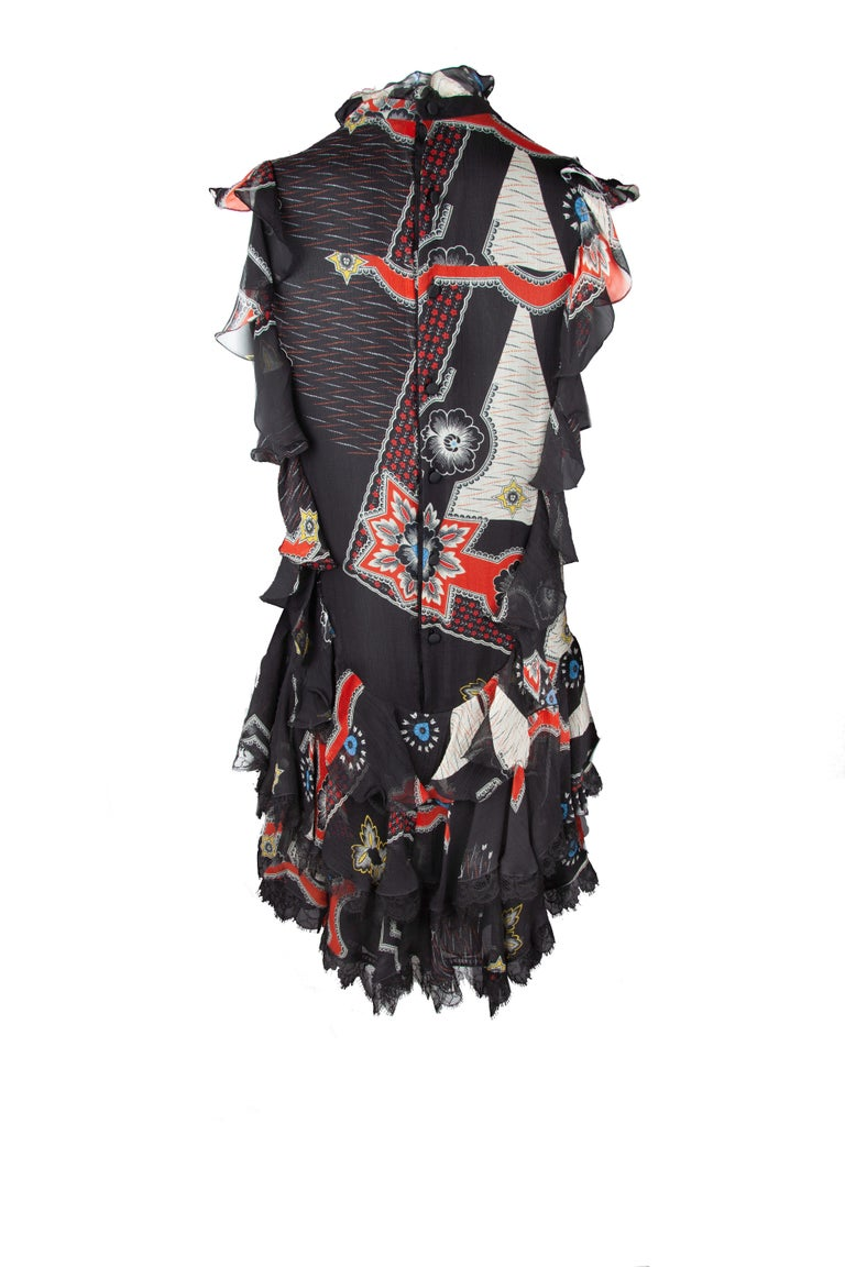 This Fall 2018 Runway Etro mini dress features a black and red silk print, a tiered ruffled silhouette, lace detailing in hem, a mock neckline, and a back button down closure. A fun, feminine piece that can be dressed up or down, making a statement