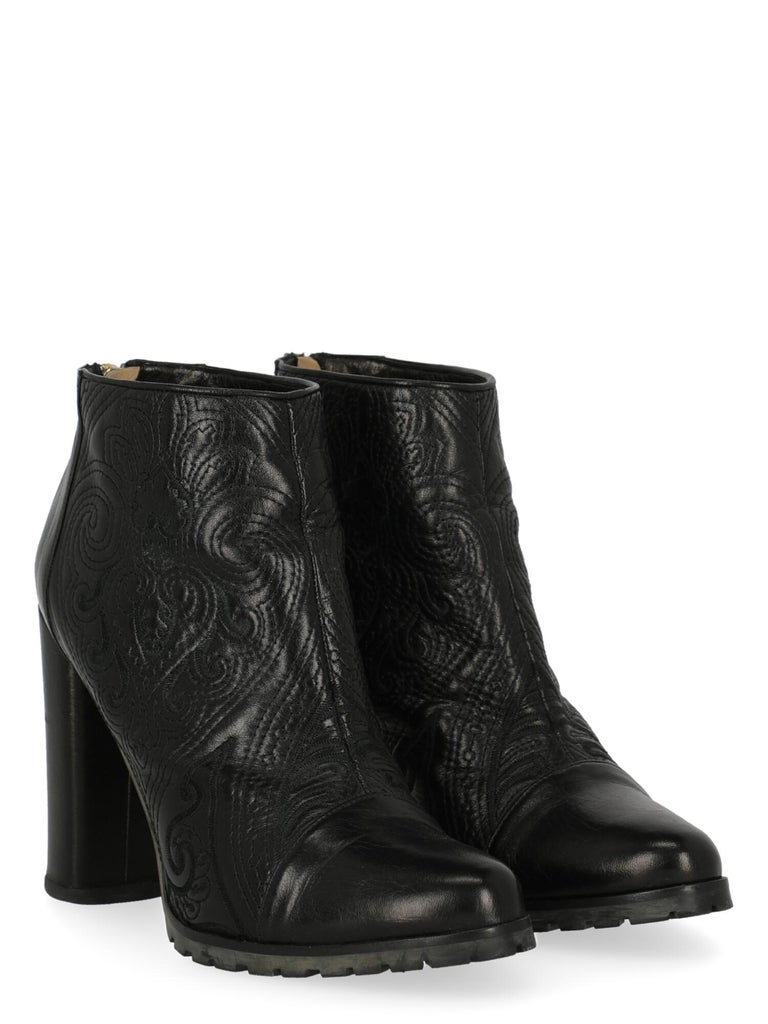 Product Description: Ankle boots, leather, solid color, back zipper fastening, ligth gold-tone hardware, round toe, branded sole, block heel, high heel  Includes: N/A  Product Condition: Very Good Heel: slightly visible scuffing. Sole: visible signs