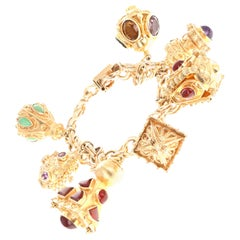 Etruscan Revival 18 Karat and 14 Karat Yellow Gold Charm Bracelet