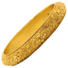 Etruscan Revival 22 Karat Yellow Gold Floral Bangle Bracelet