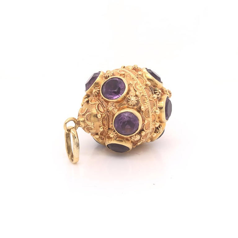 Amazing detail on this vintage treasure. The charm is crafted in 18k yellow gold with details seen throughout. The charm shows Etruscan period details and is set with Amethyst gemstones throughout. Each Amethyst gemstone weighs approximately .75 -