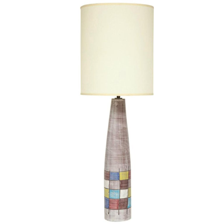 Ettore Sottsass Bitossi for Raymor lamps, ceramic, patchwork, signed. Pair of tall pink gray glaze ceramic lamps with square patchwork pattern in yellow, blues, red, white and sepia. This pattern was produced by Bitossi in 1955 for Raymor. Signed