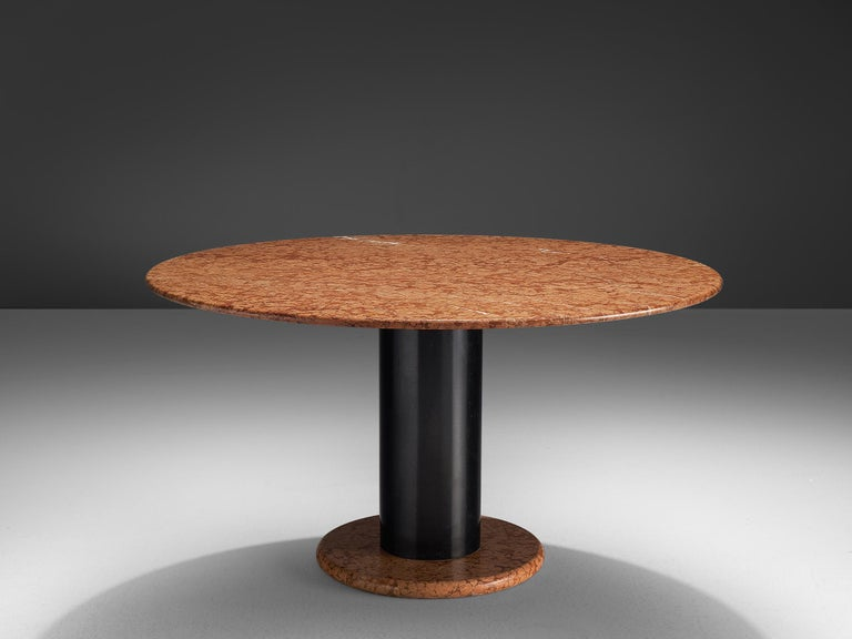 Ettore Sottsass for Poltronova, pedestal table, in red marble and metal, Italy, 1965.   Round pedestal table by Italian designer Ettore Sottsass. A orange-pink round base with black metal cylindrical column. The round top is executed in beautiful