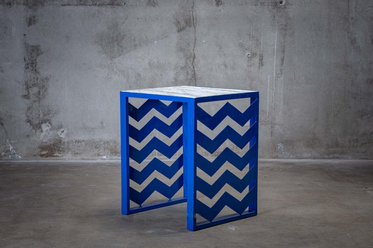 Ettore Sottsass (1917-2007) Italian marble top side table with blue painted metal base.