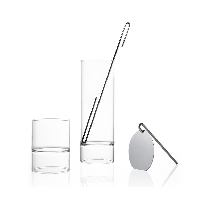 The contemporary Czech glass minimal Revolution collection set includes a cocktail mixer carafe, strainer, stir stick, and four double-ended Rocks Martini glasses. 