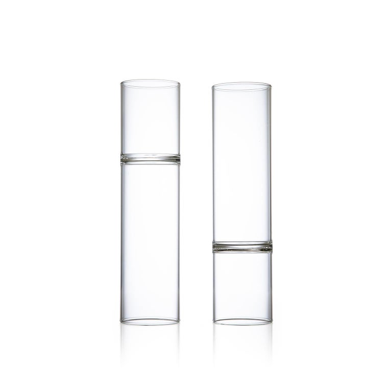 This set includes two clear minimal revolution champagne flute glasses.  This item is also available in the US.  Strikingly modern in form, the double ended contemporary Revolution collection is handcrafted in the Czech Republic by master