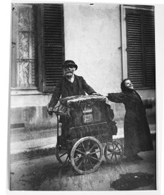 Organ Grinder, Paris, 1899, by Eugene Atget, printed by Berenice Abbott