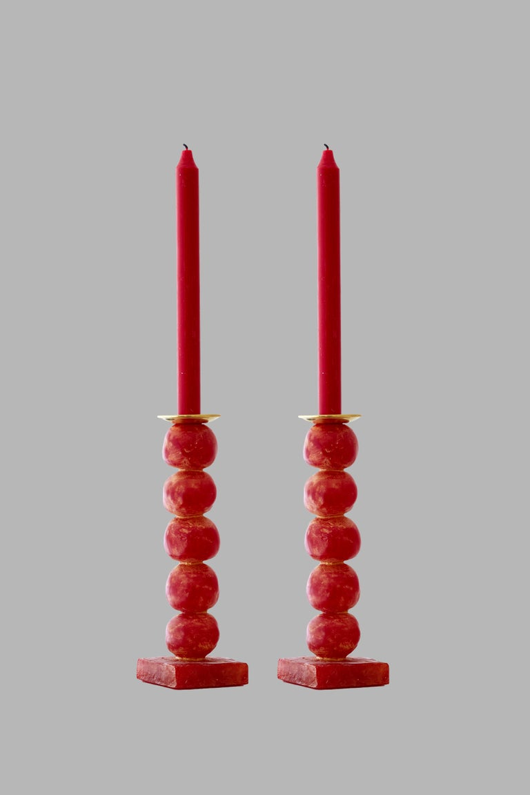 Margit Wittig has used her sculptural skills to create beautifully-crafted, well-proportioned contemporary candlesticks, which are compositions of her unique signature pearl-shaped designs.  Each candlestick begins as hand-sculpted spheres which