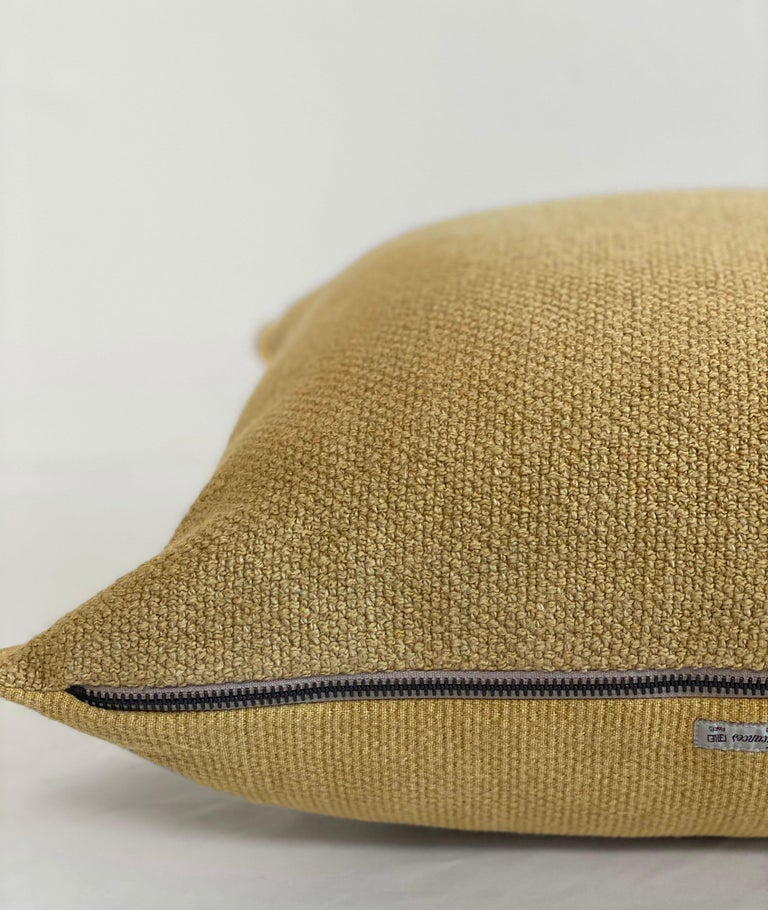Gold Mustard colored linen blend accent pillow. Beautiful nubby soft texture with decorative edge. Linen blend, with soft nubby texture. Please allow 4-6 weeks for production.  Size: 15 x 24 Down insert included Metal zipper closure Color: Paille