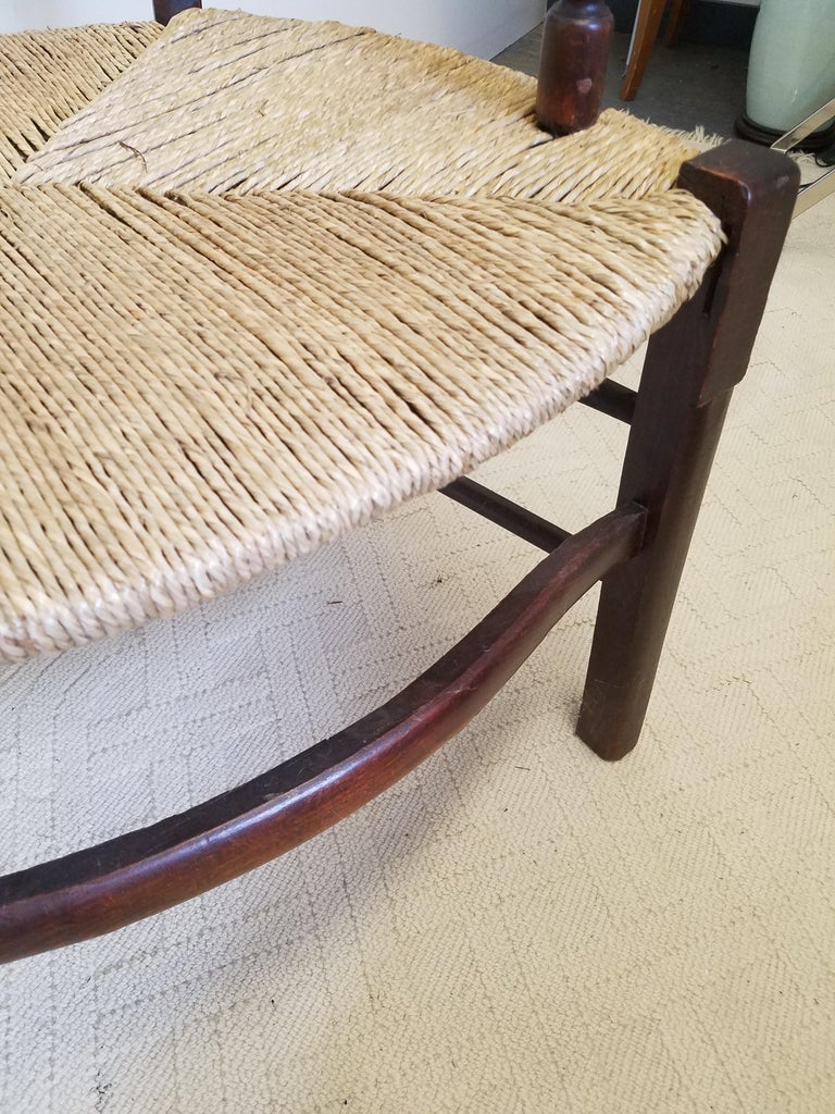 European Hand Carved Dark Oak Armchair with Rush Seat In Excellent Condition For Sale In Lambertville, NJ