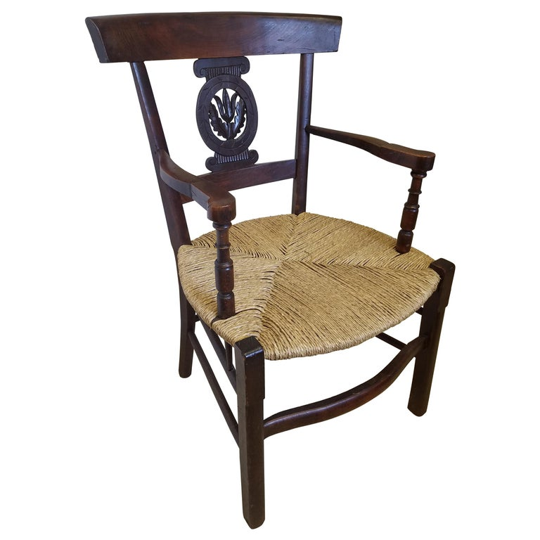 European Hand Carved Dark Oak Armchair with Rush Seat For Sale