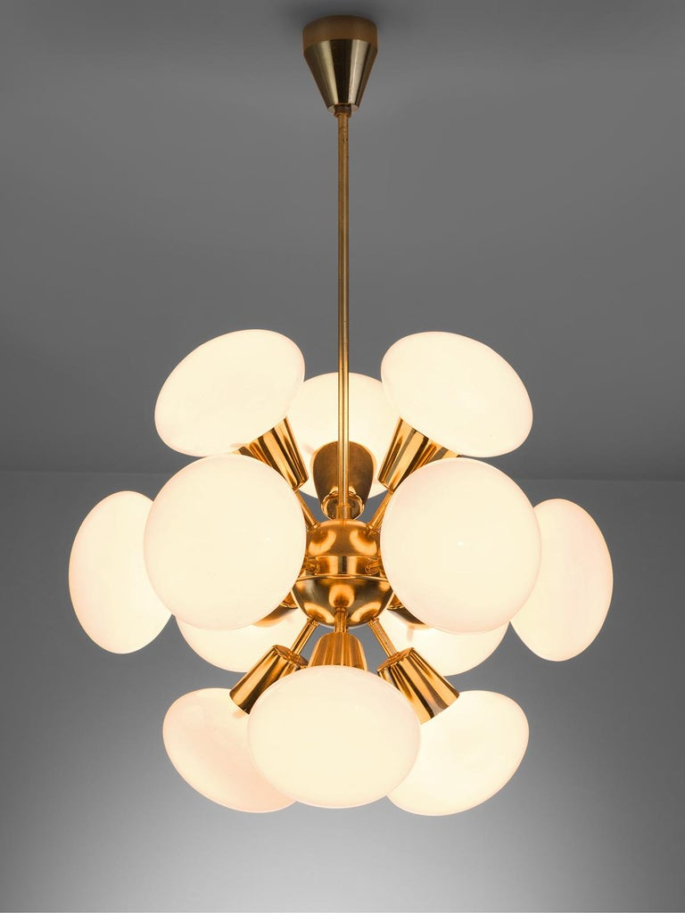 Sputnik chandelier, in brass and opaline glass, Europe, 1970s. 